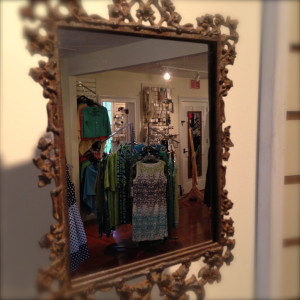 An elegant mirror on the mantel at Jane Morgan's Little House.